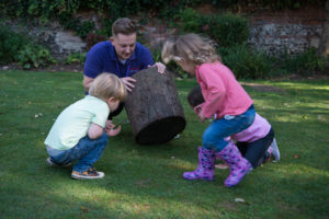 Tiny Tots Staff in the garden with children